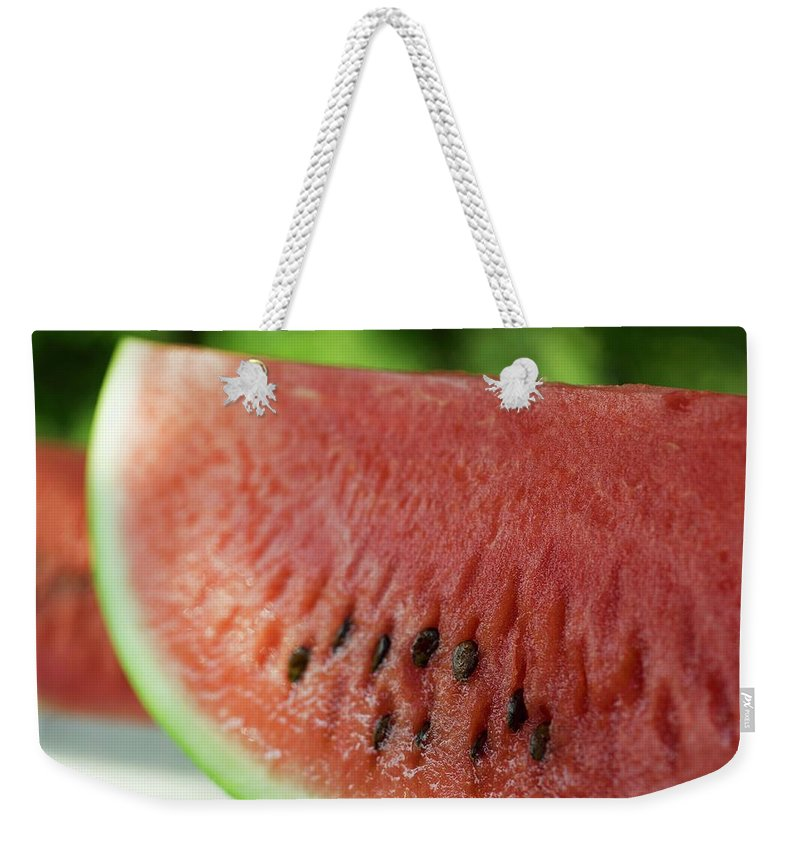 Bowler Hat Weekender Tote Bag featuring the photograph Two Slices Of Watermelon by Foodcollection