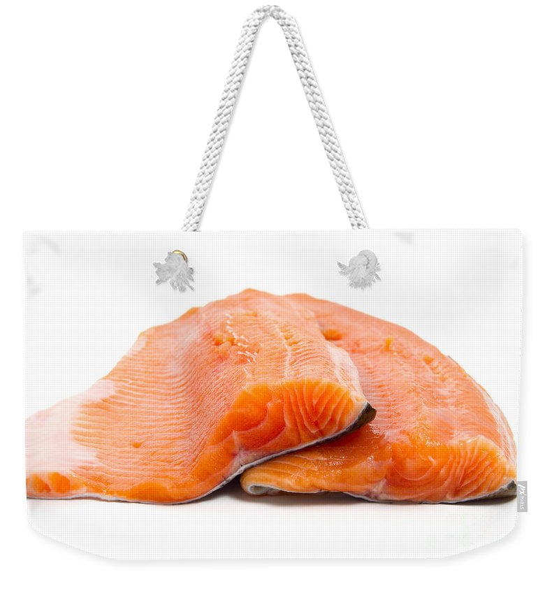 Background Weekender Tote Bag featuring the photograph Two Trout Fillets by Antonio Scarpi