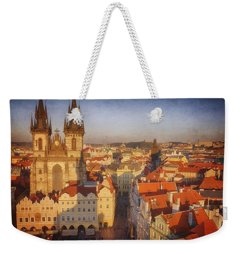 Gothic Style Weekender Tote Bag featuring the photograph Tyn Church Old Town Square by Joan Carroll