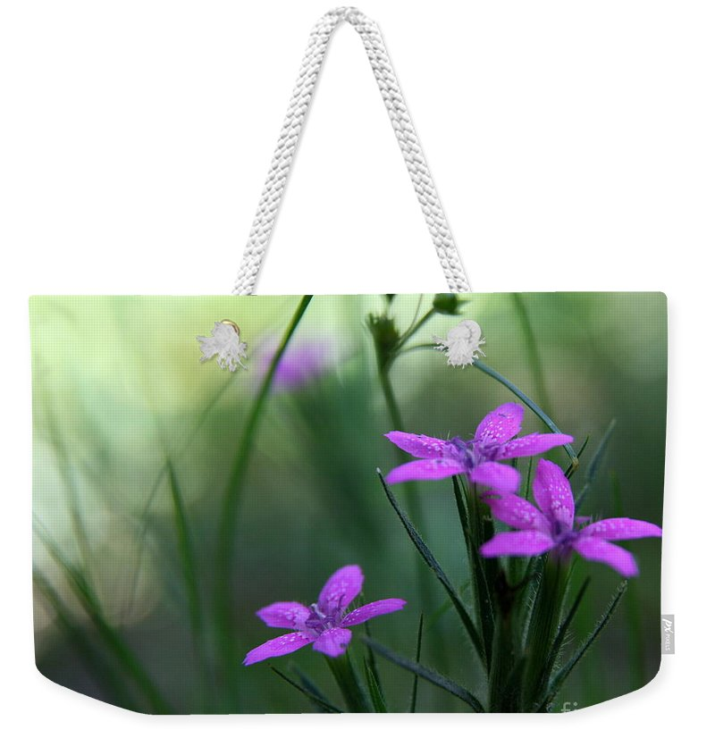Purple Weekender Tote Bag featuring the photograph Ultra Violet by Neal Eslinger