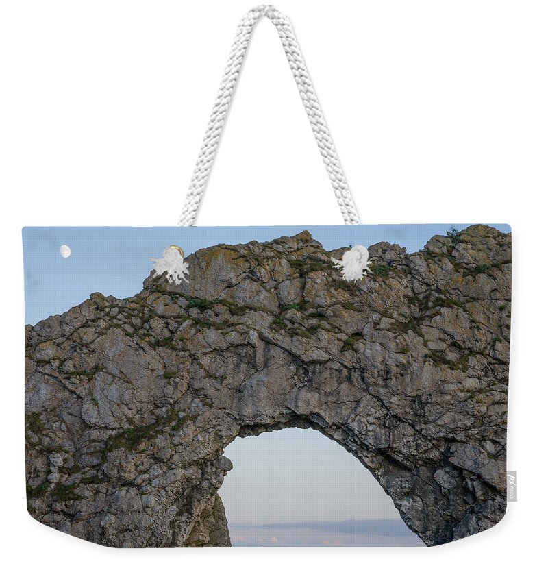 Durdle Weekender Tote Bag featuring the photograph Under The Rising Moon by Ian Middleton