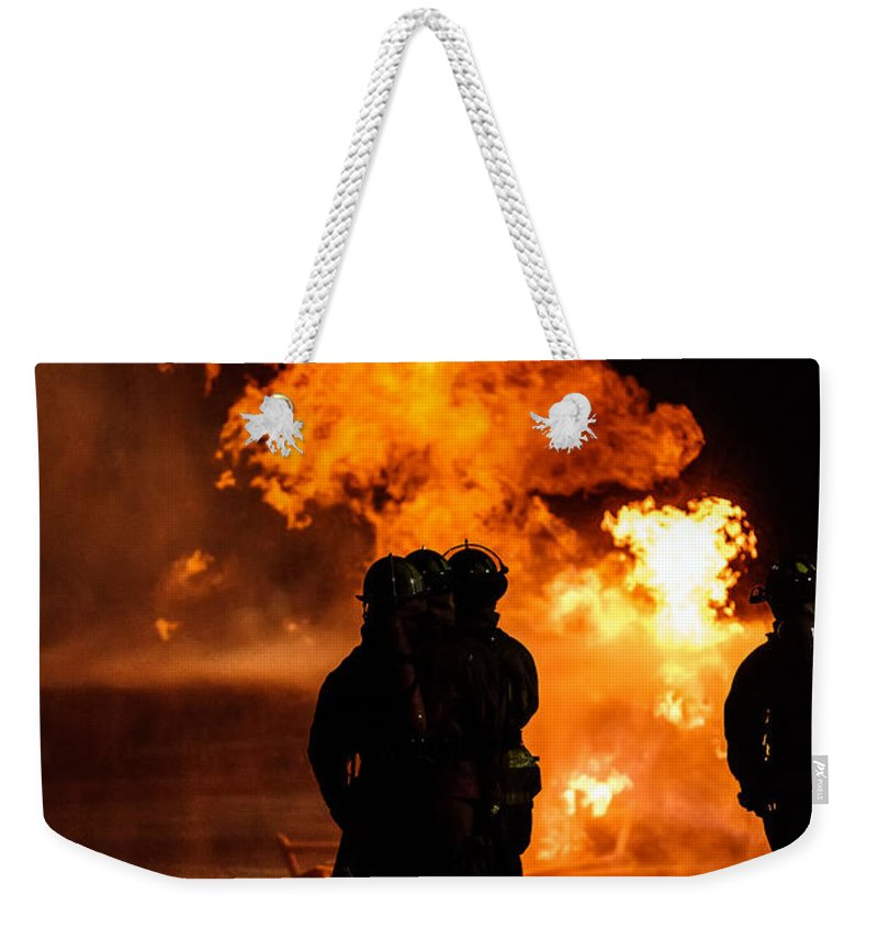 Extinguish Weekender Tote Bag featuring the photograph Up Close And Personal by Sennie Pierson