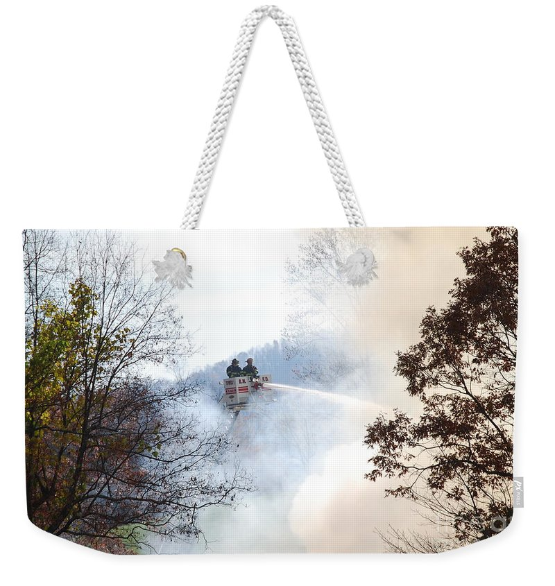 Fire Weekender Tote Bag featuring the photograph Up In Smoke by Eric Liller