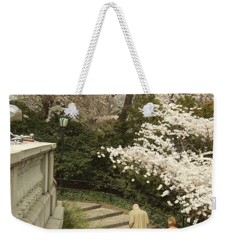Weekender Tote Bag featuring the photograph Up The Cherry Steps by Katerina Naumenko