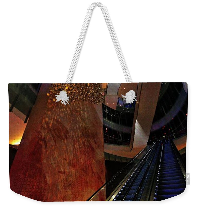 Escalators Weekender Tote Bag featuring the photograph Up The Down Escalator by Robert McCubbin