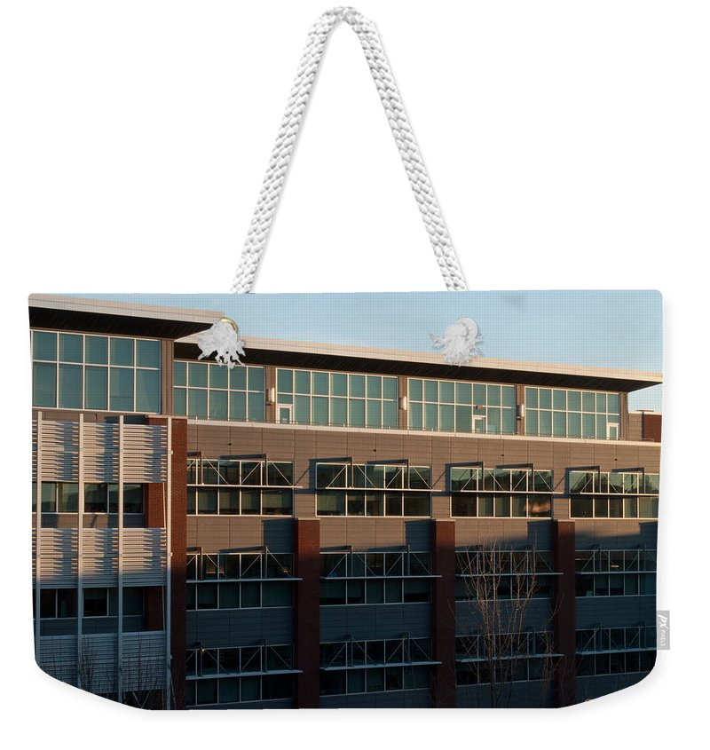 Feature Weekender Tote Bag featuring the photograph Urban Sunrise Glow by Paulette B Wright