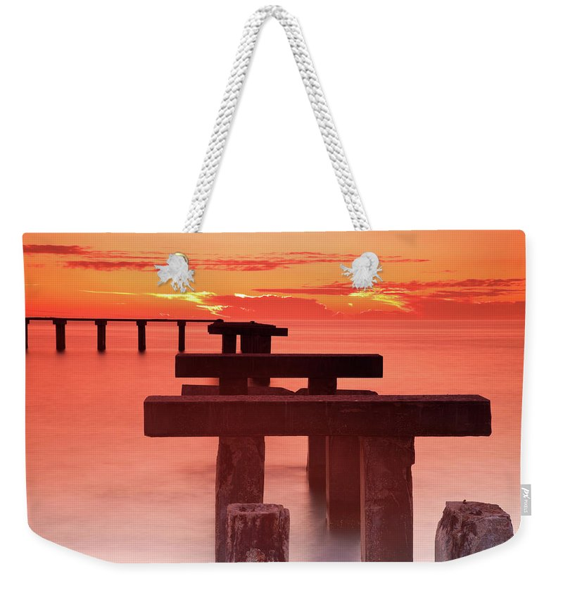 Tranquility Weekender Tote Bag featuring the photograph Usa, Florida, Boca Grande, Ruined Pier by Henryk Sadura