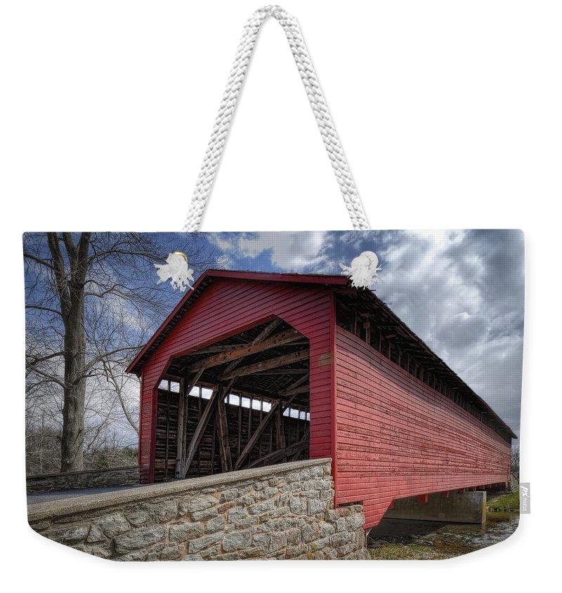 Utica Mills Weekender Tote Bag featuring the photograph Utica Mills Covered Bridge by Joan Carroll