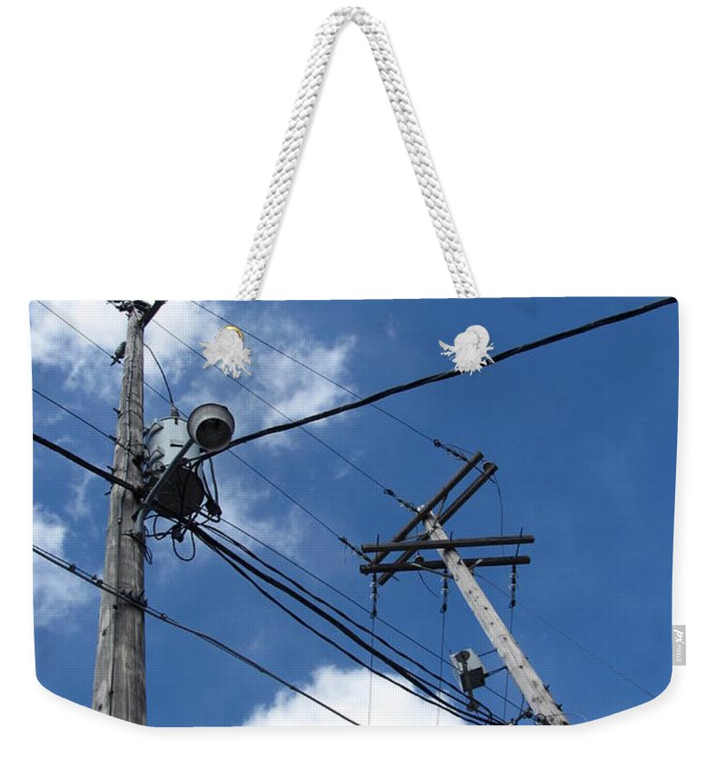 Utility Pole Weekender Tote Bag featuring the photograph Utility Poles And Clouds 2 by Anita Burgermeister