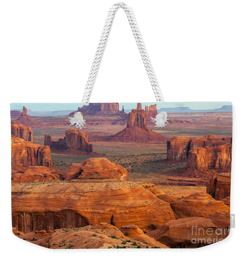 Monument Valley Weekender Tote Bag featuring the photograph Valley Of Monuments At Dawn by Bob Phillips