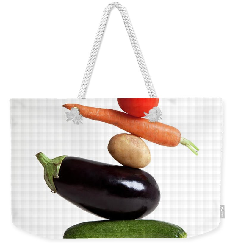 Shadow Weekender Tote Bag featuring the photograph Vegetables Arranged In A Stack by Halfdark