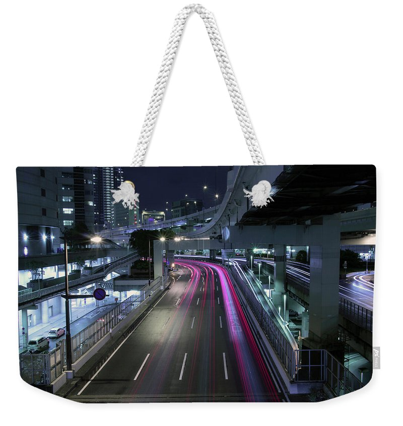 Yokohama Weekender Tote Bag featuring the photograph Vehicle Light Trails On National Route 1 by Digipub