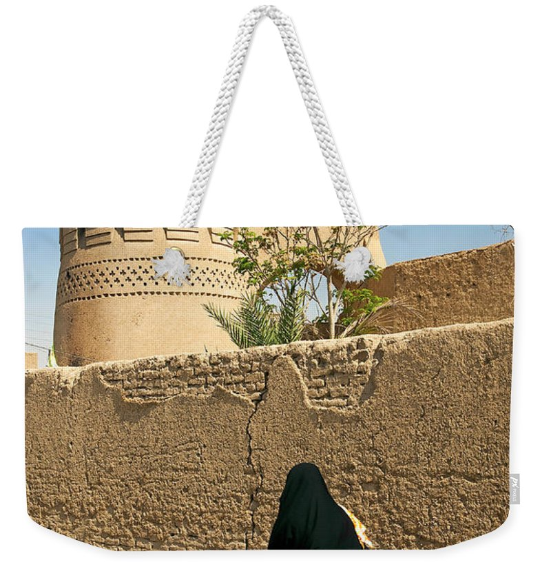 Woman Weekender Tote Bag featuring the photograph Veiled Woman In Yazd Street In Iran by Jacek Malipan