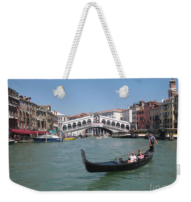 Venice Gondolier Weekender Tote Bag featuring the photograph Venice Gondolier by John Malone