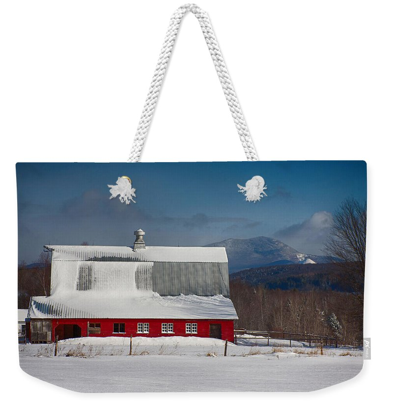 image By Jeff Folger Weekender Tote Bag featuring the photograph Vermont Barn In Snow With Mountain Behind by Jeff Folger