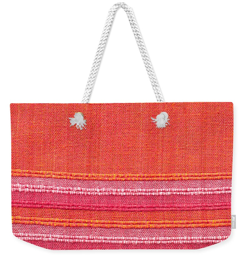 Abstract Weekender Tote Bag featuring the photograph Vibrant Cloth by Tom Gowanlock