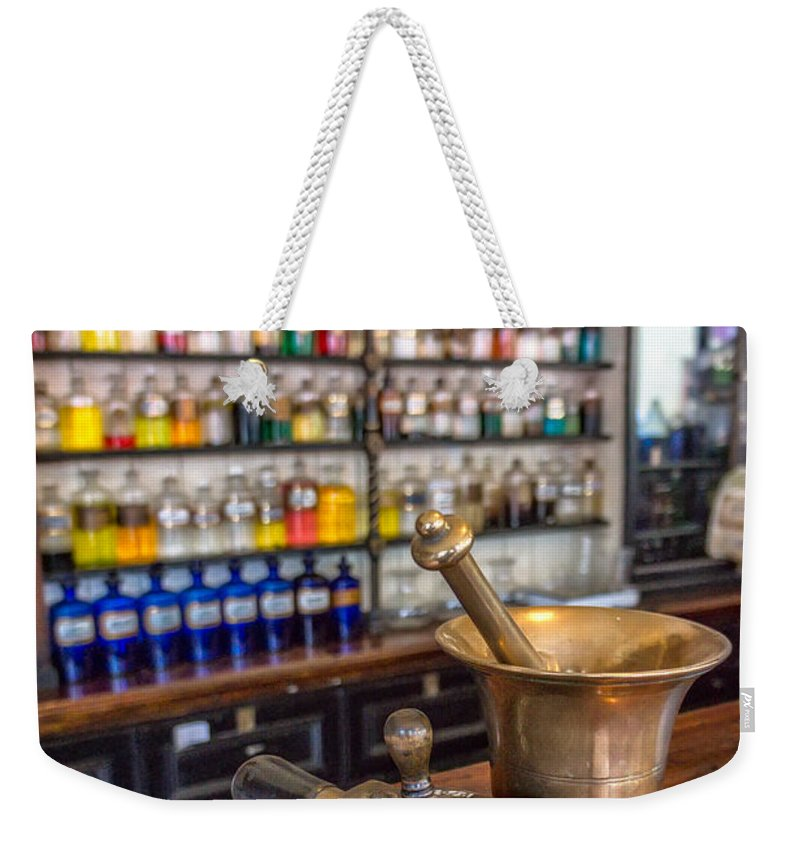 British Weekender Tote Bag featuring the photograph Victorian Chemist Equipment by Adrian Evans