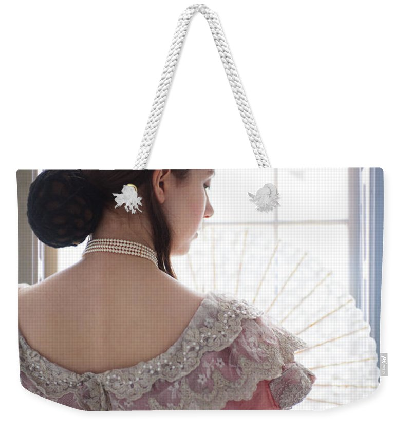 Victorian Weekender Tote Bag featuring the photograph Victorian Woman By A Window by Lee Avison