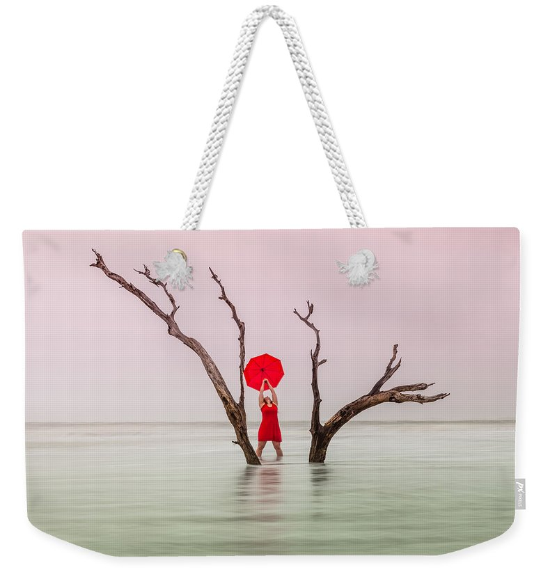 Woman Weekender Tote Bag featuring the photograph Uncertain Victory by Carol VanDyke