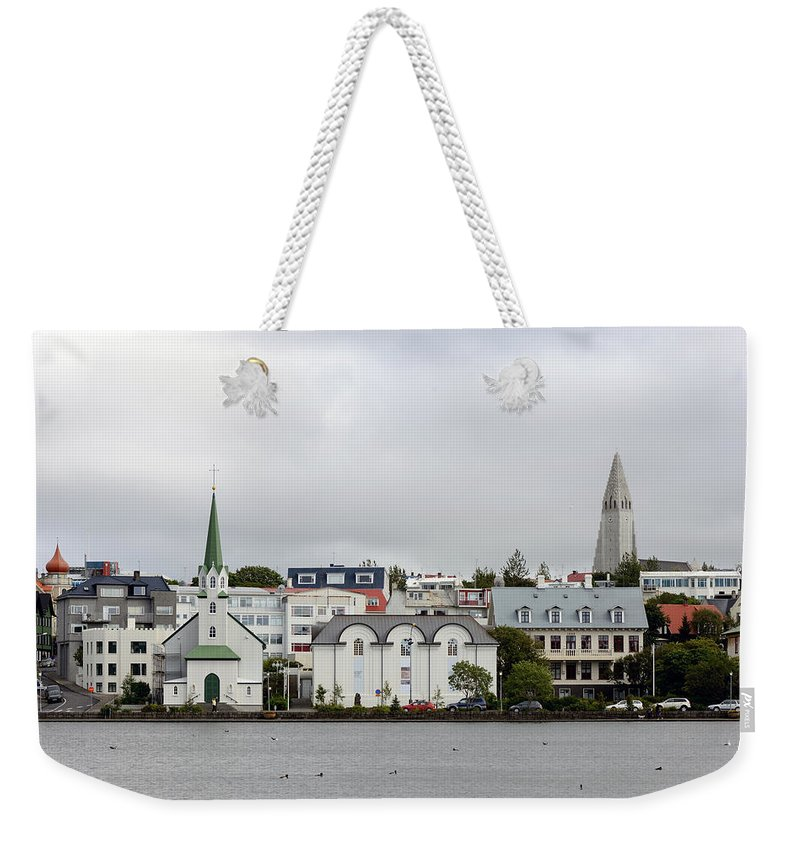 Tj�rnin Weekender Tote Bag featuring the photograph View Across The Tjornin by Ian Ashbaugh