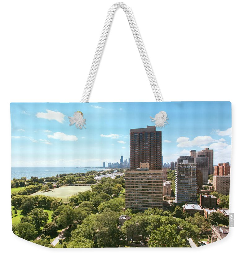 Lake Michigan Weekender Tote Bag featuring the photograph View Of Chicago Skyline And Lake by Sasha Weleber
