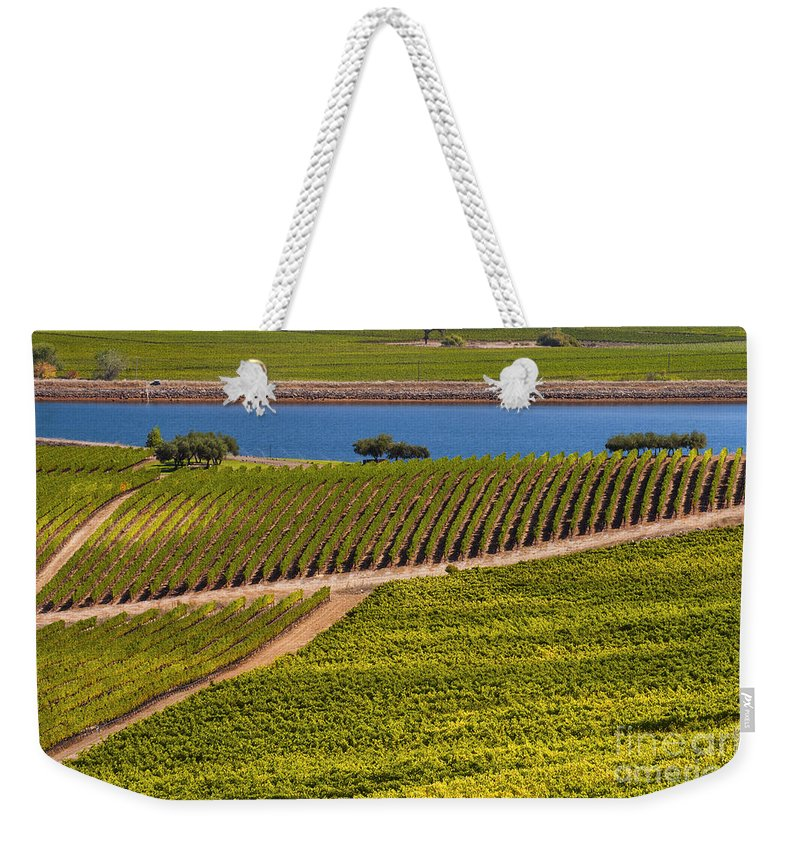 Napa Valley California Wineries Winery Grapevine Grapevines Row Rows Landscape Landscapes Plant Plants Vineyard Vineyards Pond Ponds Lake Lakes Water Weekender Tote Bag featuring the photograph Vineyard On A Lake by Bob Phillips