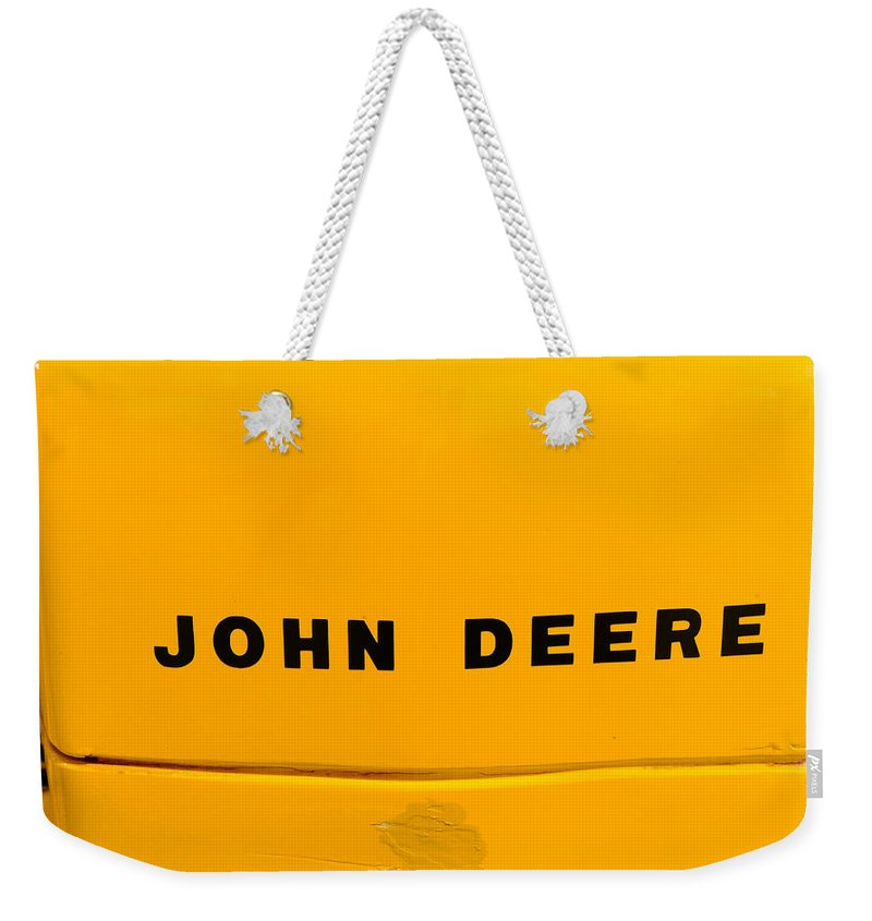 Paul Ward Weekender Tote Bag featuring the photograph Vintage 1952 John Deere Tractor In Yellow by Paul Ward
