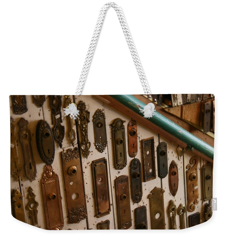 Hippo Hardware Weekender Tote Bag featuring the photograph Vintage And Antique Door Knob And Lock Plates by Elizabeth Rose