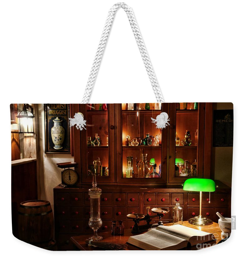 Apothecary Weekender Tote Bag featuring the photograph Vintage Apothecary Shop by Olivier Le Queinec