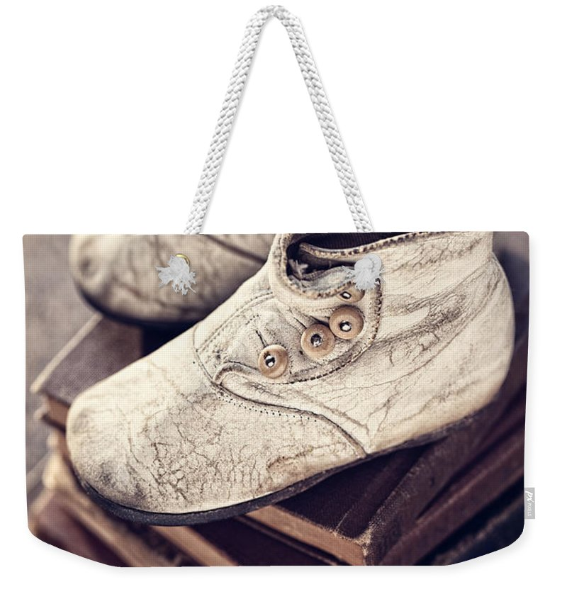 Antique Weekender Tote Bag featuring the photograph Vintage Baby Boots And Books by Leslie Banks