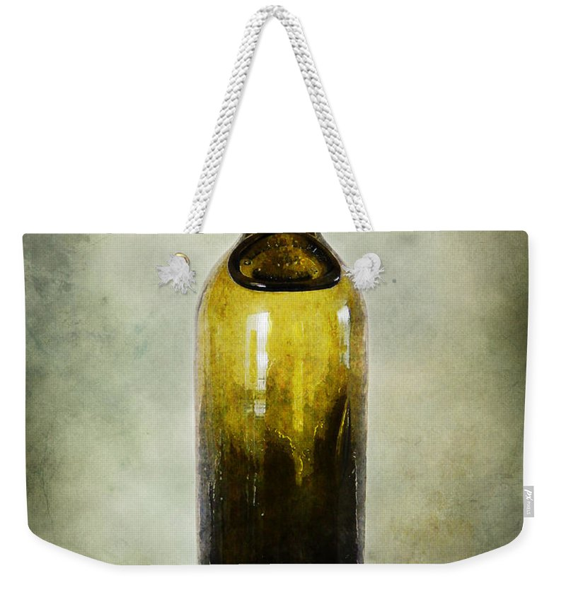 Bottle Weekender Tote Bag featuring the photograph Vintage Green Glass Bottle by Phil Perkins