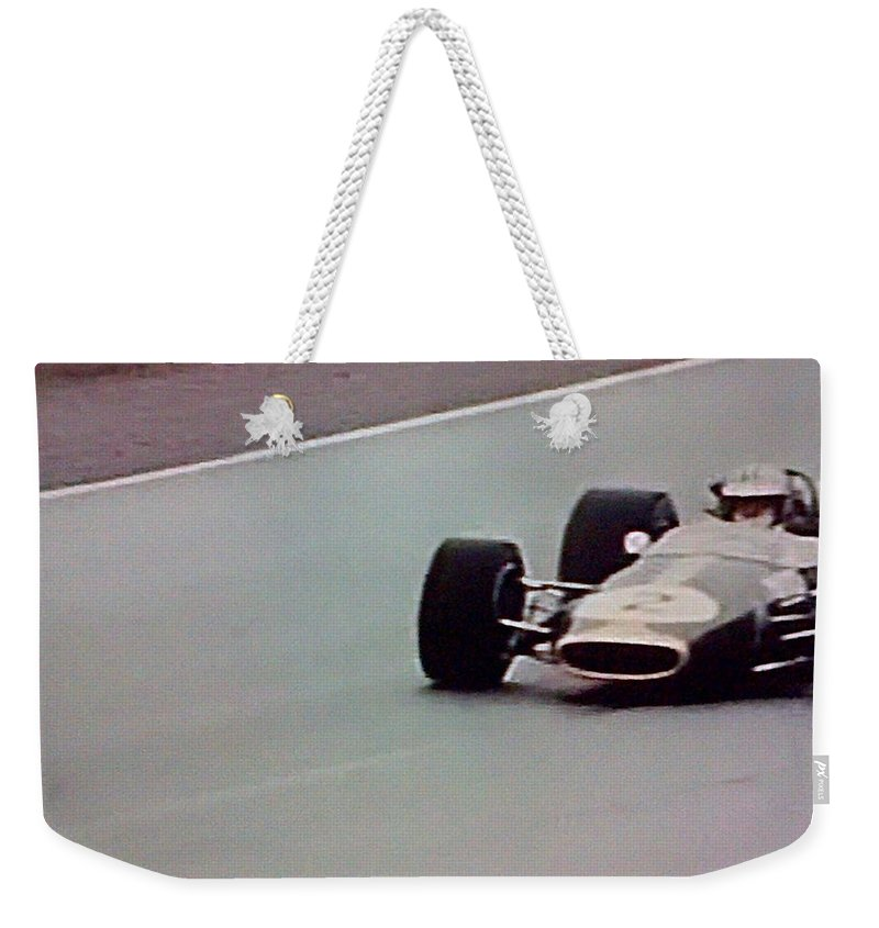 Formula 1 Racing Weekender Tote Bag featuring the photograph Vintage Lotus Racer In Action by George Pedro