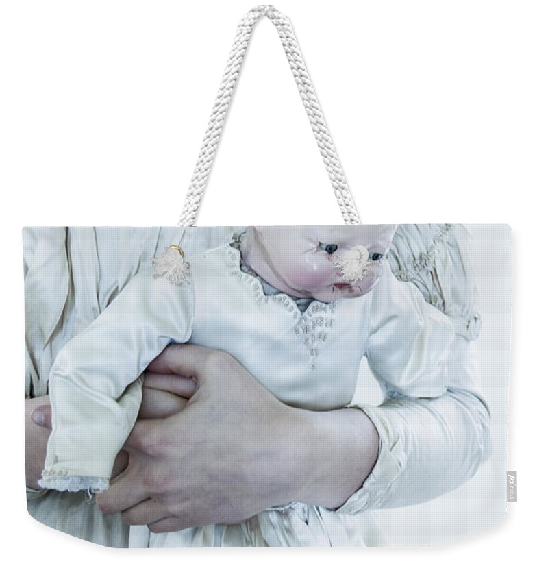 Caucasian; Female; Woman; Lady; Young Woman; Vintage; Dress; Victorian; Prim; Proper; Feminine; Beautiful; Pretty; Lovely; Indoors; Inside; Ornate; Cream; Doll; Baby; Toy; Broken; Arm; Feet; Boots; Antique; Cracked; Wood; Wooden; Porcelain; Hold; Holding Weekender Tote Bag featuring the photograph Vintage Love by Margie Hurwich