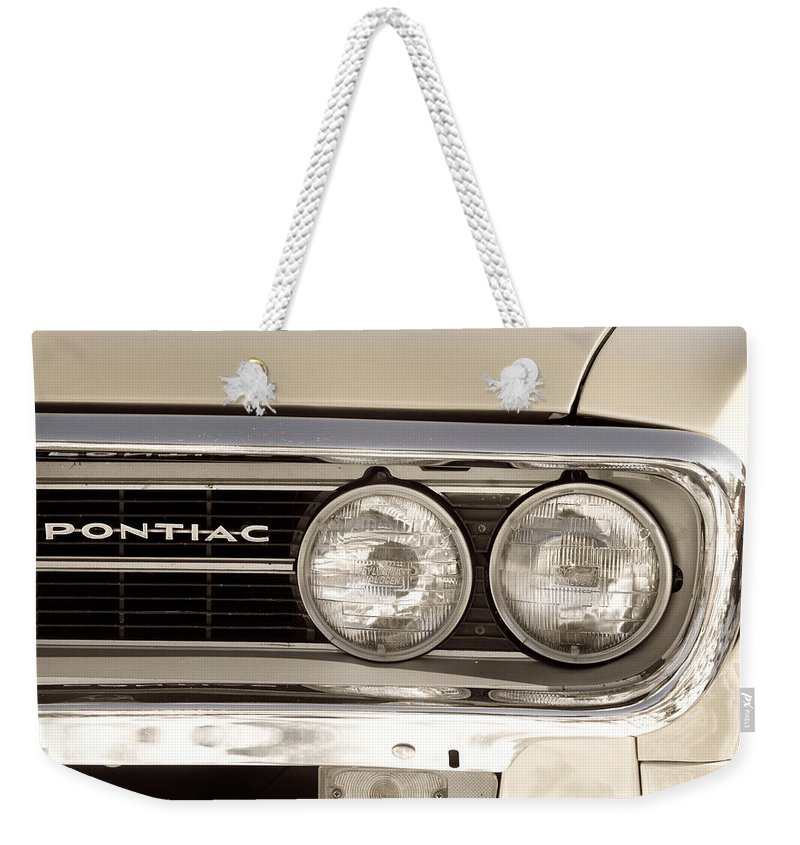 Automobiles Weekender Tote Bag featuring the photograph Vintage Pontiac Firebird 1967 Close Up by James BO Insogna