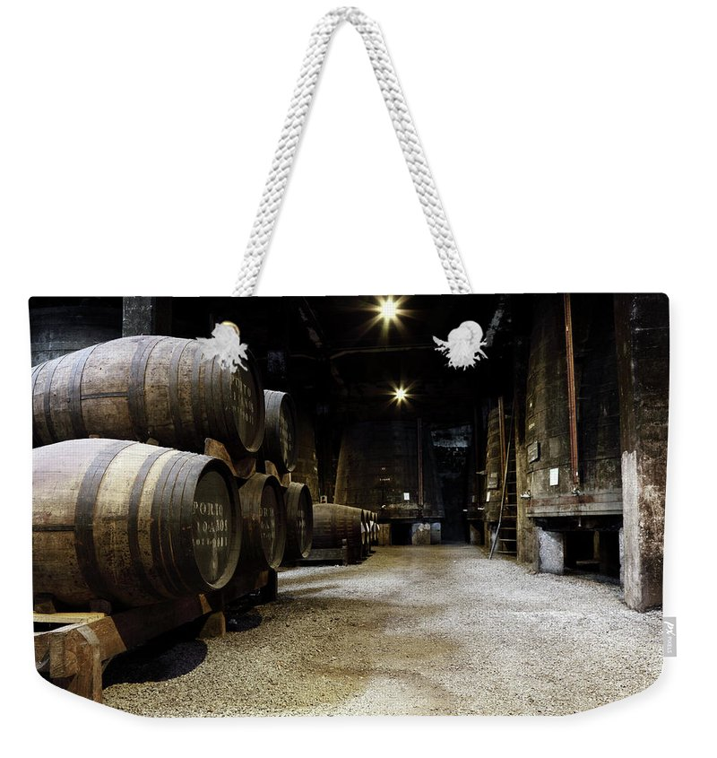 Desaturated Weekender Tote Bag featuring the photograph Vintage Porto Wine Cellar by Vuk8691