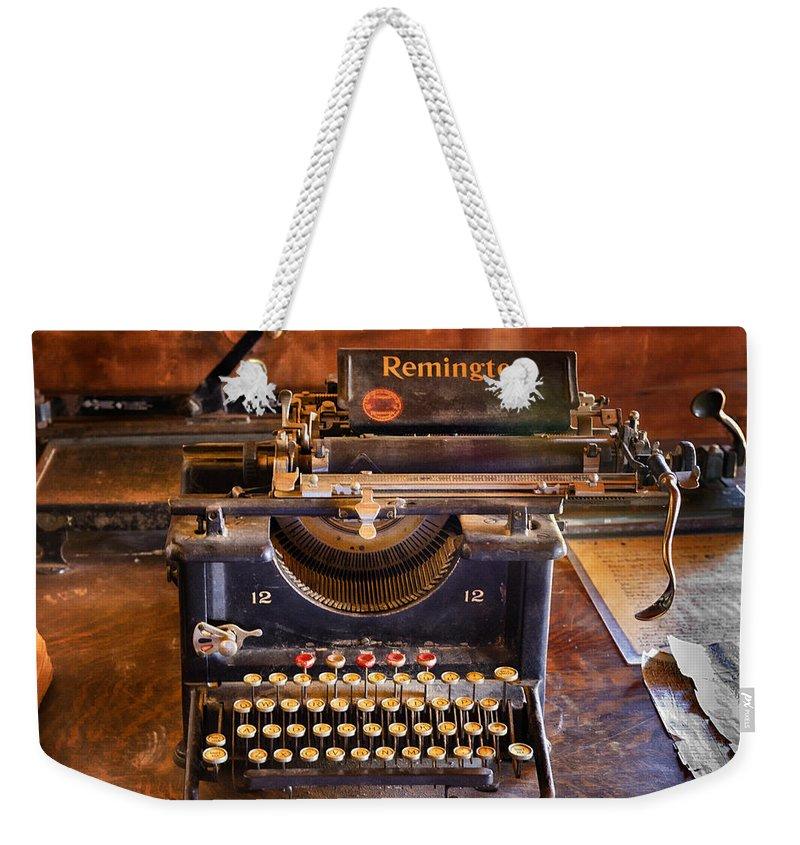 Remington Weekender Tote Bag featuring the photograph Vintage Remington Typewriter by Saija Lehtonen