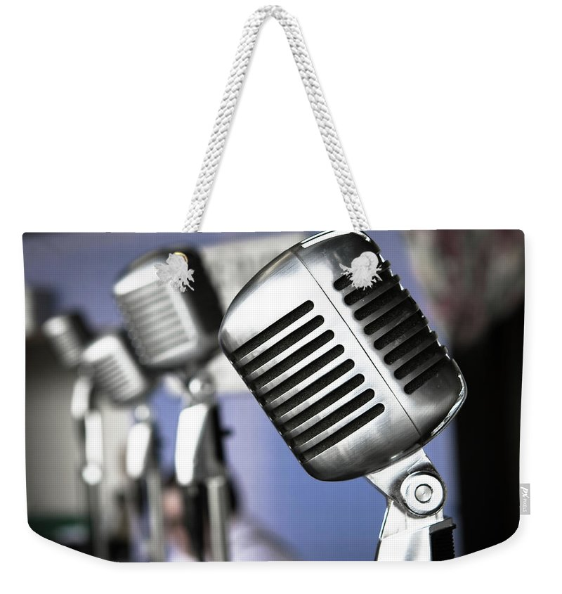Music Weekender Tote Bag featuring the photograph Vintage Standing Radio Microphones by Photo By Brian T. Evans