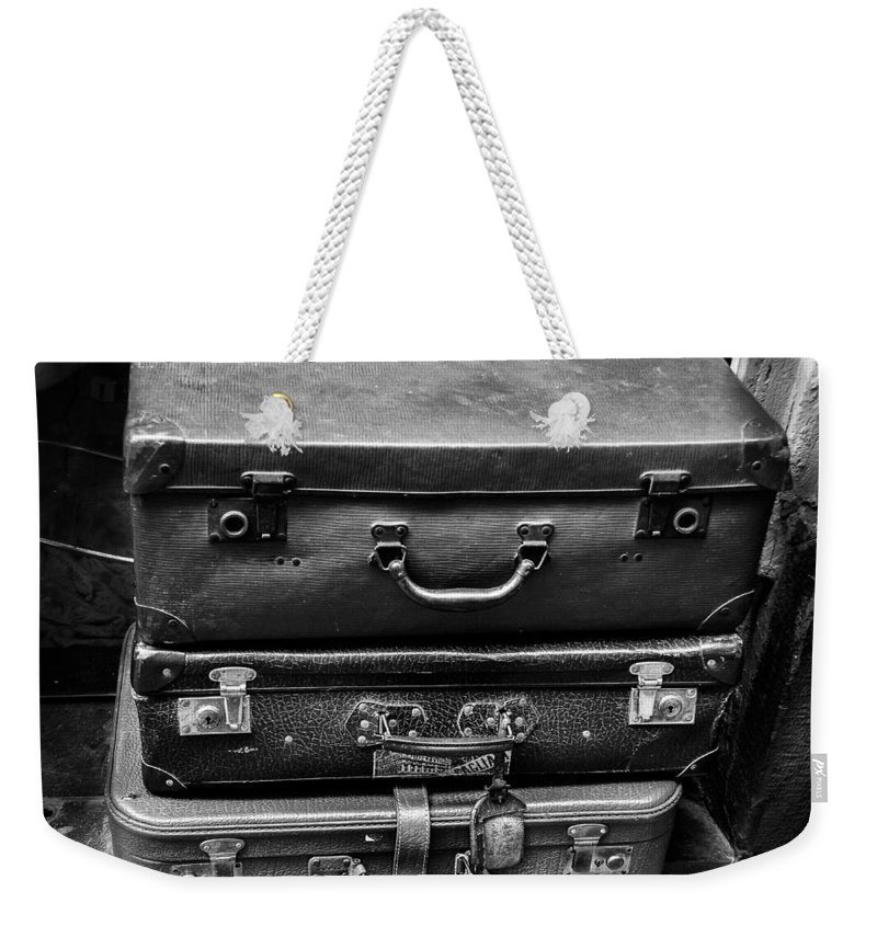 Traveler Weekender Tote Bag featuring the photograph Vintage Suitcases by Dany Lison