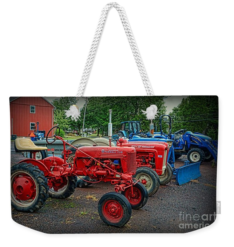 Paul Ward Weekender Tote Bag featuring the photograph Vintage Tractors by Paul Ward