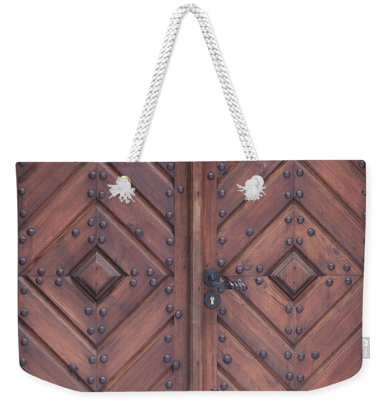 Material Weekender Tote Bag featuring the photograph Vintage Wooden Brown Door Close-up by Bogdan Khmelnytskyi