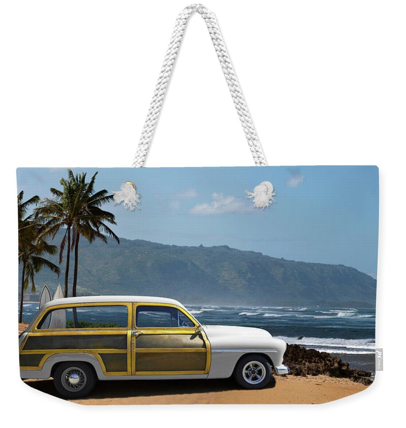 Haleiwa Weekender Tote Bag featuring the photograph Vintage Woody On Hawaiian Beach by Ed Freeman