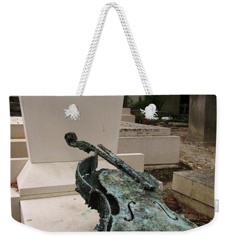Pere Lachaise Cemetery Weekender Tote Bag featuring the photograph Violen Sculpture In Pere Lachaise Cemetery by John Malone