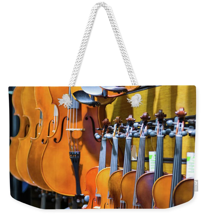 Istanbul Weekender Tote Bag featuring the photograph Violin Shop by Salvator Barki