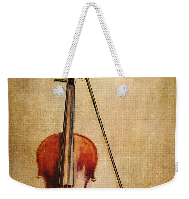 Violin Weekender Tote Bag featuring the photograph Violin With Bow by Emily Kay