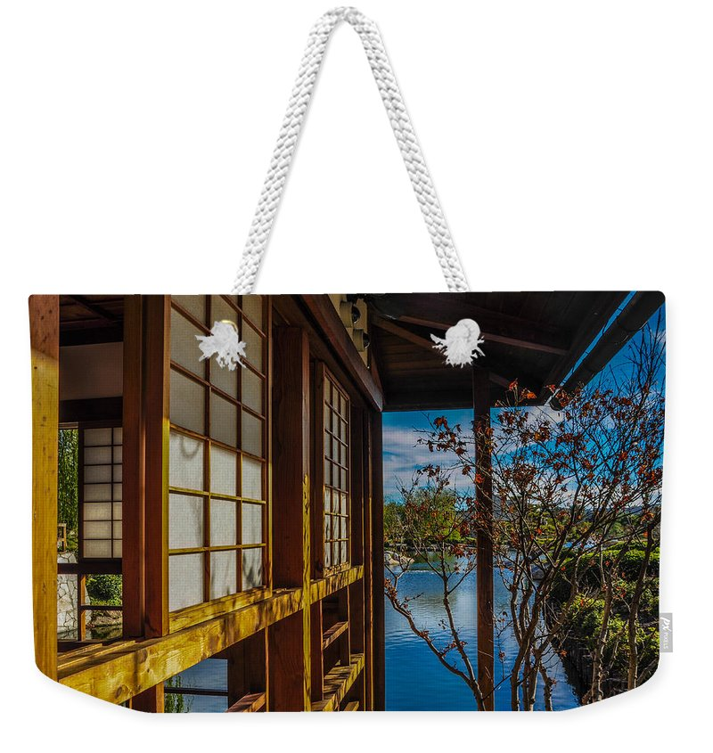 Suihoen Weekender Tote Bag featuring the photograph Suihoen's Vision Of Peace by Keisha Marshall