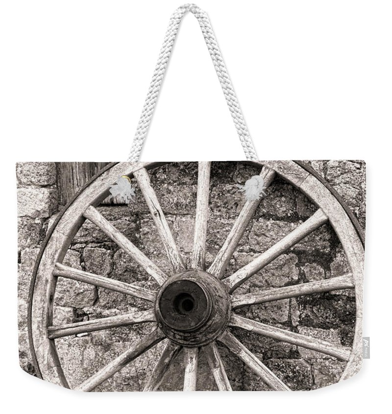 Wagon Weekender Tote Bag featuring the photograph Wagon Wheel by Olivier Le Queinec