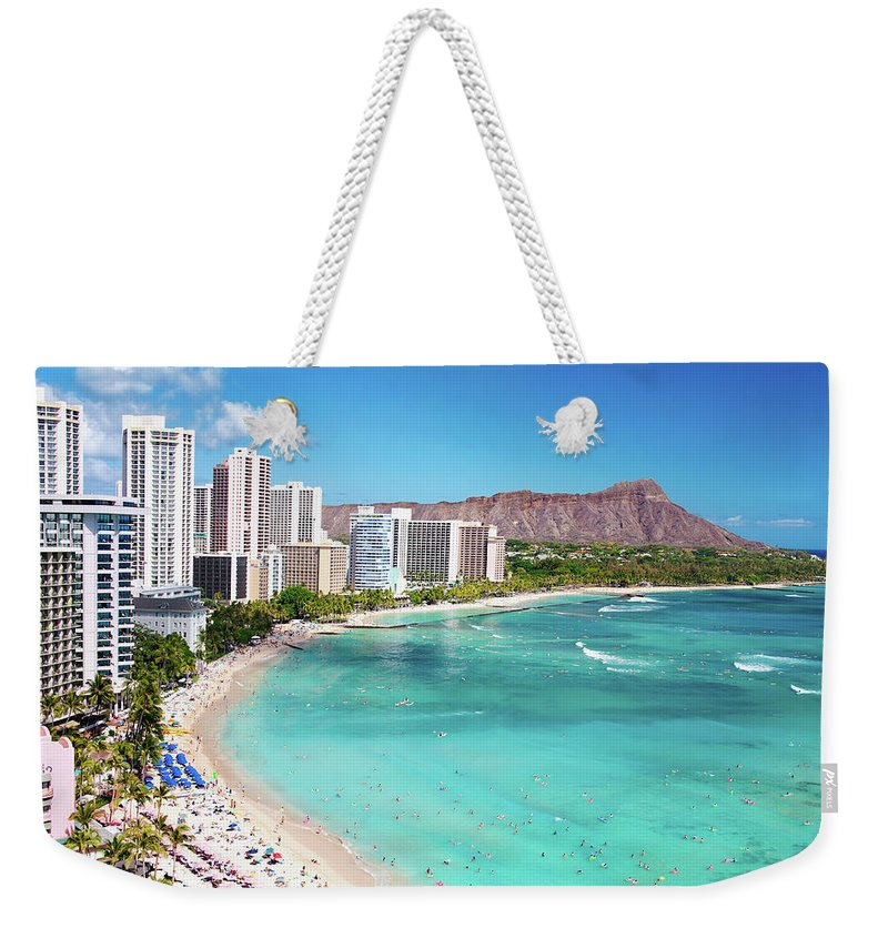 Water's Edge Weekender Tote Bag featuring the photograph Waikiki Beach by M Swiet Productions