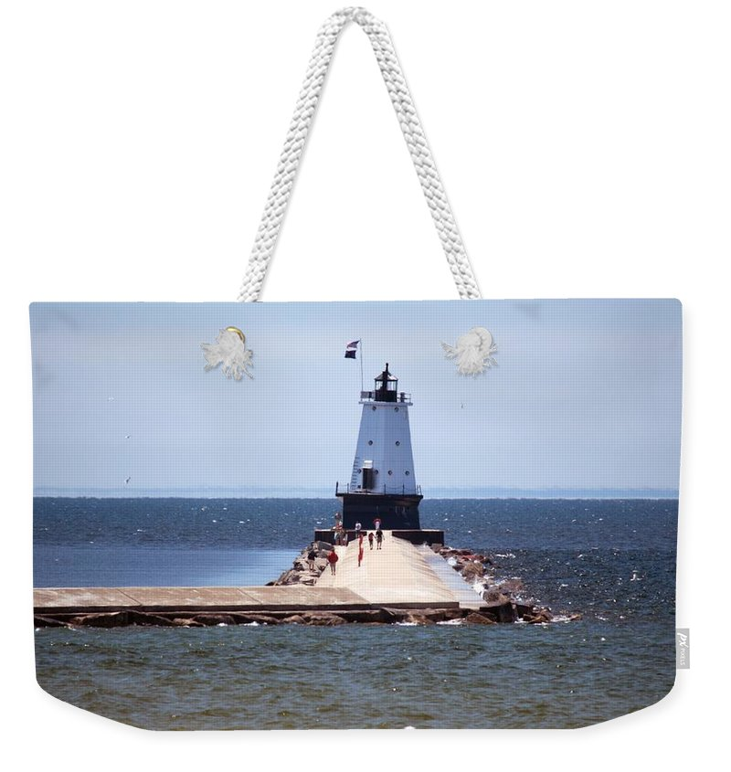 Ludington Weekender Tote Bag featuring the photograph Walking Out by Linda Kerkau