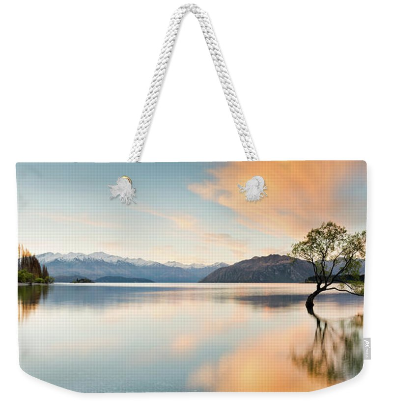 Tranquility Weekender Tote Bag featuring the photograph Wanaka - Lone Tree Sunrise At Lake by Kathryn Diehm