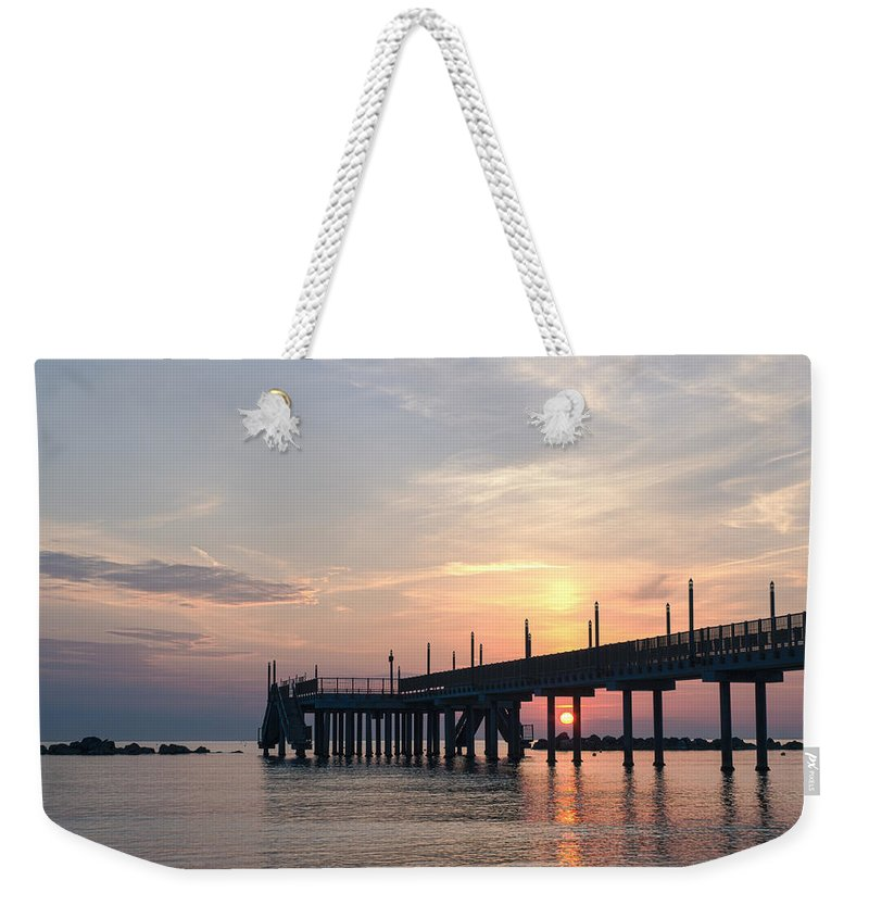 Staring At The Sun Weekender Tote Bag featuring the photograph Wander by Andrea Mazzocchetti